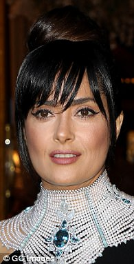 They faked it, too! Bella Hadid, 20, Cara Delevingne, 24, and Salma Hayek (pictured), 50, have all also used clip-in bangs to transform their looks this season