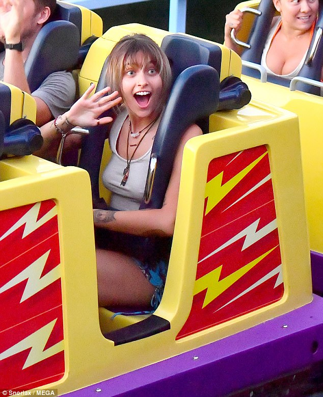 Scream if you want to go faster:The ride proved to be quite the adrenaline rush for Paris as she screamed her way through with a male friend, waving and smiling when it slowed down