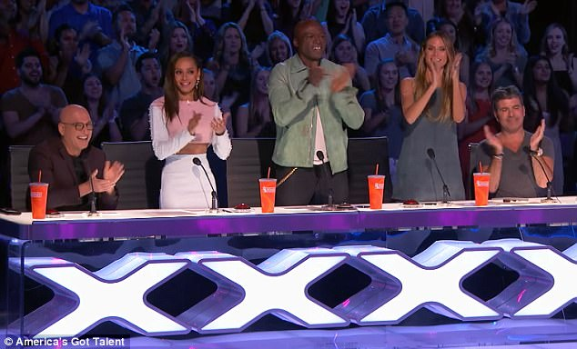 A pleased crowd: Judges Heidi, Seal and Mel B. gave the dancing duo a standing ovation and some in the audience even shed tears