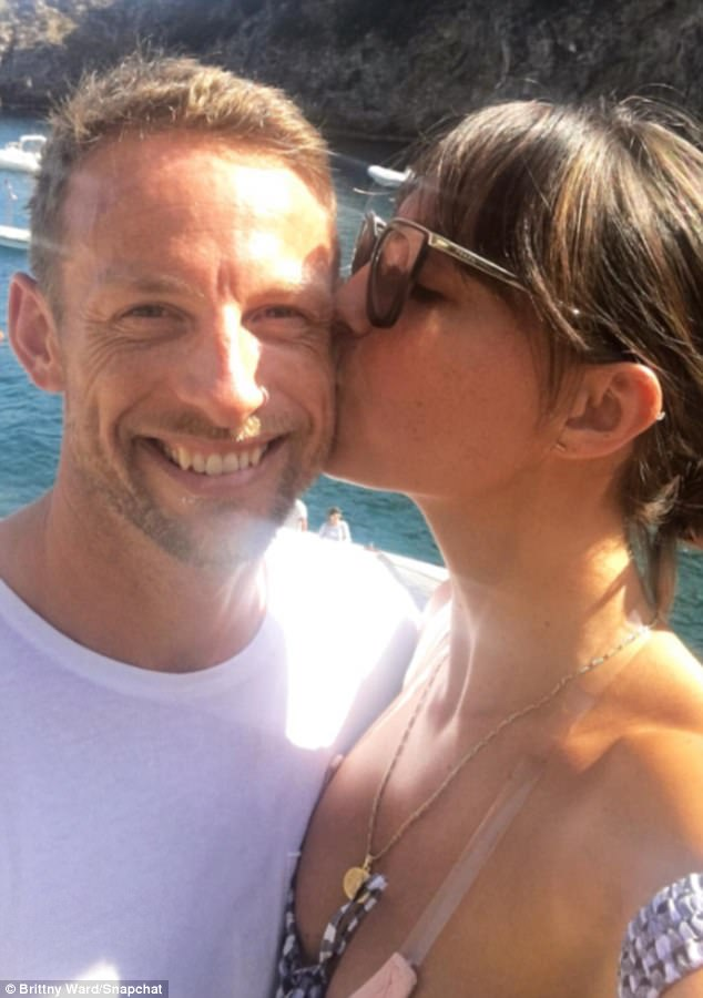 Love again: Jenson looked pleased as punch as he cosied up to his girlfriend of almost 18 months