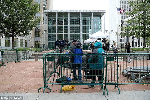 Media gather outside the Alfred A. Arraj United States Courthouse ahead of the Taylor Swift trial in Denver. Colorado