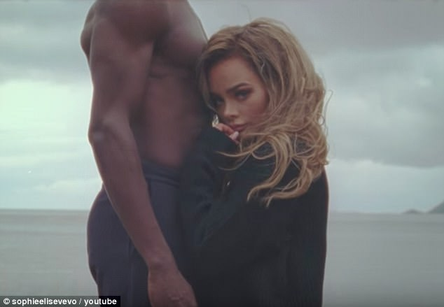 Horrifying: Norwegian singer Sophie Elise has been subjected to death threats after the release of her new video All Of Your Friends in which she stars opposite a black actor