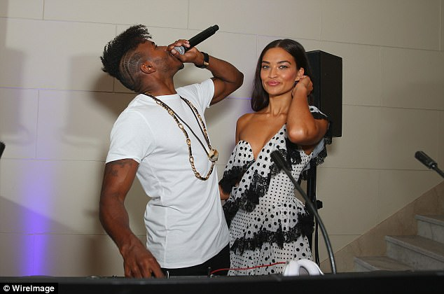 Say cheese:He was joined by Shanina, who posed for photos alongside her man in the booth