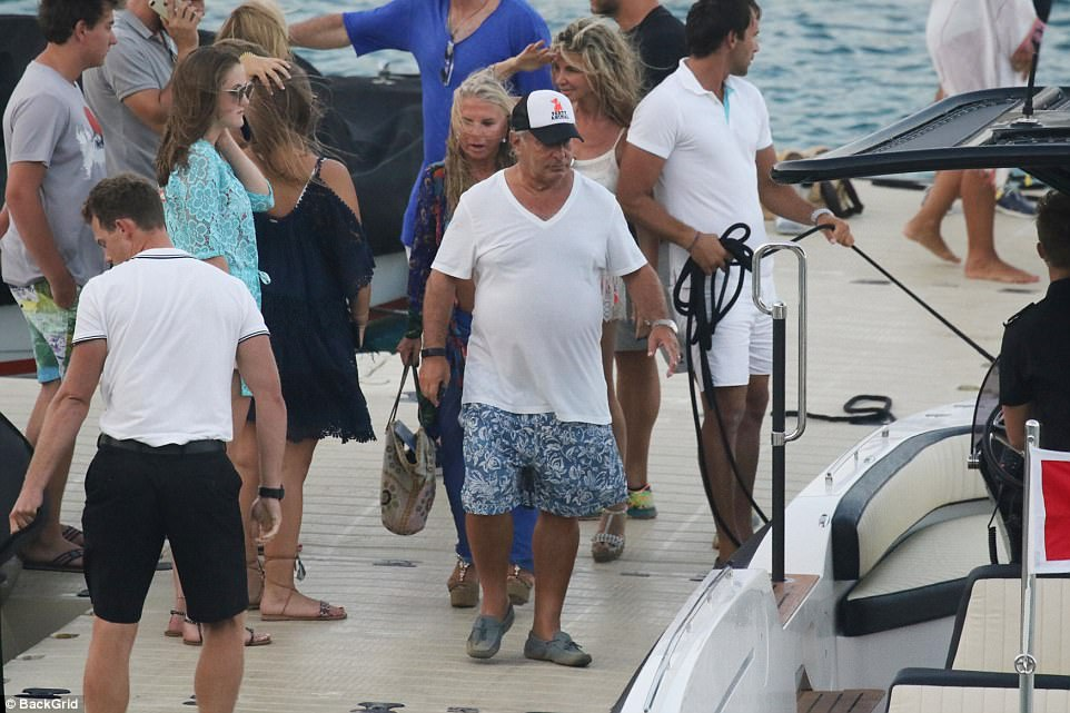 The couple, and a large group of friends, were pictured chatting to fellow boat owners during their visit to the Greek isle