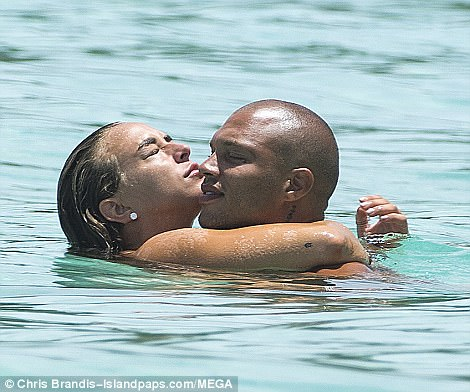 All going swimmingly: Chloe and Jeremy heated up their display of passion when they jumped into the sea, barely able to stay away from one another as they cosied up together for a kiss and a cuddle in the water