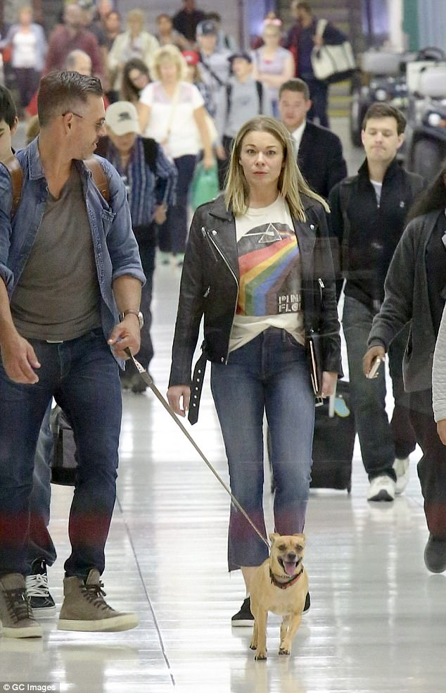 Low-key look: Dressed down for the outing, LeAnn looked stylish in a Pink Floyd T-shirt that she teamed with cropped jeans and a black leather jacket