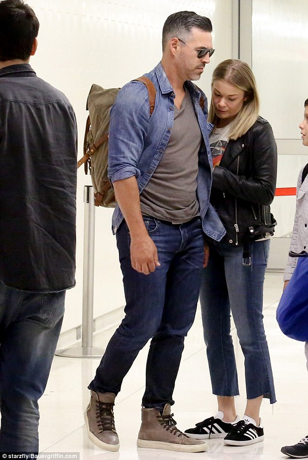 United: Eddie Cibrian, 44, and LeAnn Rimes, 34, brushed off the criticism they have received as they put on an united front at LAX airport in Los Angeles on Tuesday