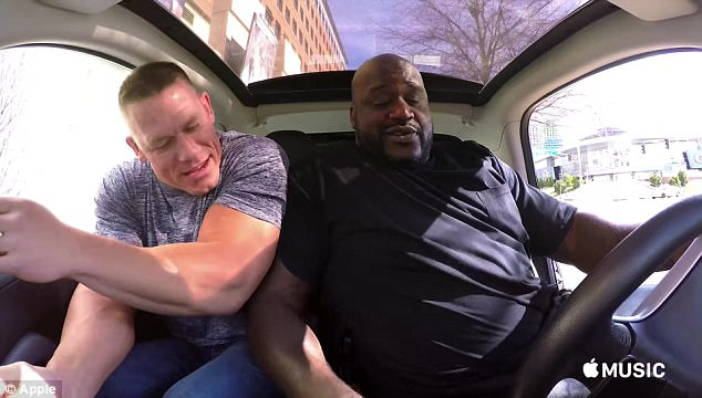 Musclemen: Shaquille O'Neal and WWE star John Cena squeeze into the car together