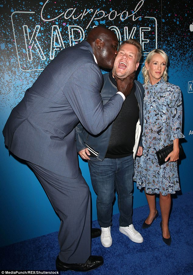 PDA alert! Retired NBA star Shaquille O'Neal jokingly planted a huge kiss on James' cheek as they enjoyed the party
