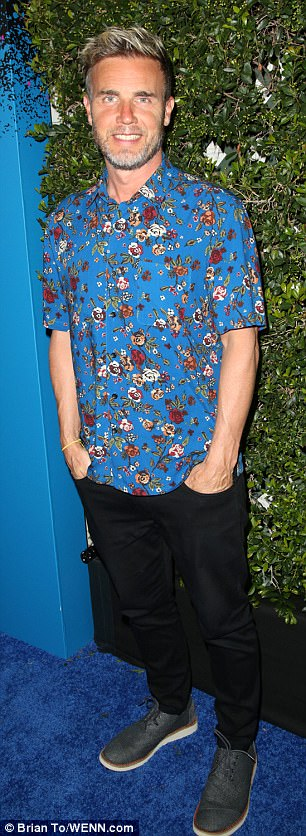 Star-studded: Take That's Gary Barlow opted for a jazzy floral shirt for the bash