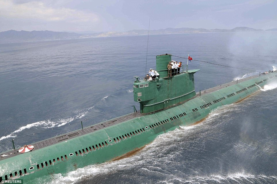 North Korea has one of the largest submarine forces in the world,comprising around 70 attack submarines (file photo of Kim Jong Un on one of his subs)