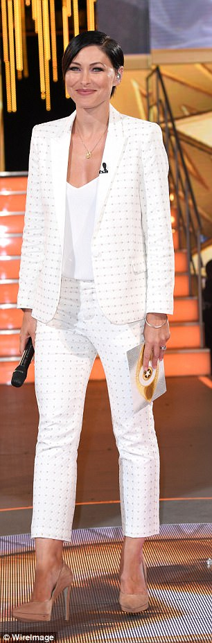 Taking centre-stage: Emma teamed her sharp trouser suit with a pair of killer understated nude stilettos