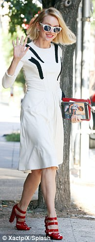 Evergreen: The two-time Oscar nominee - who turns 49 next month - looked chic in a white dress, matching shades, and patent leather red heels selected by stylist Jeanann Williams