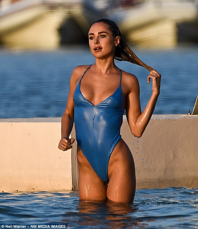 Feeling hot, hot, hot:Kimberley Garner, 27, ensured she secured the eyes of onlookers as she sizzled in the St Tropez sunshine in France in recent weeks