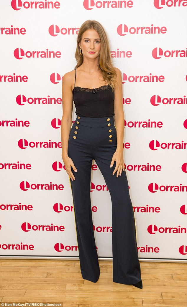 Looking good: Millie stunned in a pair of high-waisted, military inspired trousers