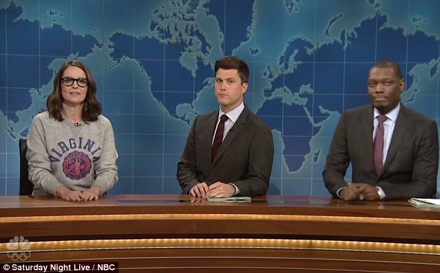Comedian Tina Fey (left) sounded off on 'Jackass Donny John Trump' during a surprise appearance on the Summer Edition of Saturday Night Live's Weekend Update on Thursday joining Colin Jost (center) and Michael Che (right) at the anchor desk