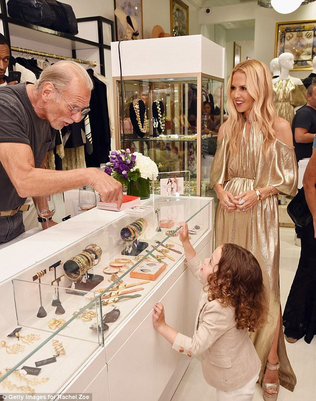Vice Chairman at What Goes Around Comes Around, Frank Bober, helps Rachel's youngest son Kaius Jagger Berman look at jewelry