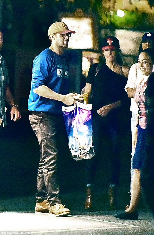 Fully loaded: Gosling had a full bag of toys by the end of his shopping spree