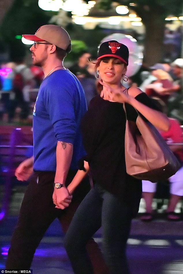Sticking together:The pair were seen holding hands while walking the magical grounds of the theme park