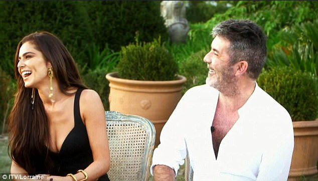 Laugh out loud: She and Simon Cowell (right) are still sharing the same level of banter as he jibes her about her baby's name