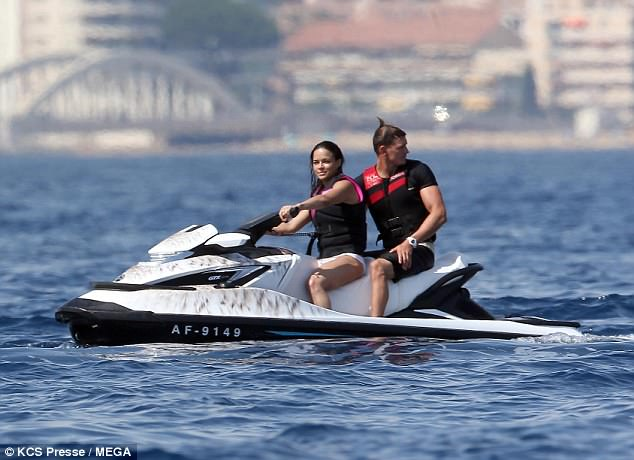 In the driver's seat: She appeared to be showing a male pal the ropes when it came to the water sport