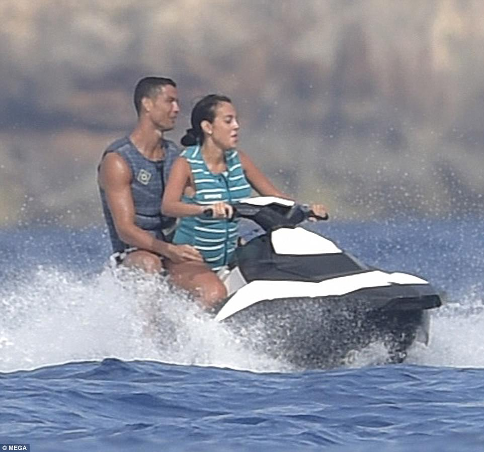 On the water: Georgina took control of a jet ski as she and Ronaldo glided across the Mediterranean