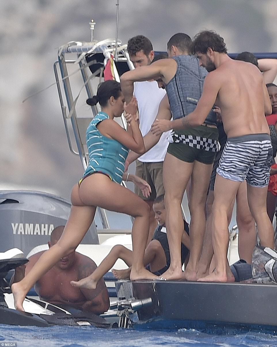 That's it: The group ensured she didn't lose her balance while finding her way onto the deck