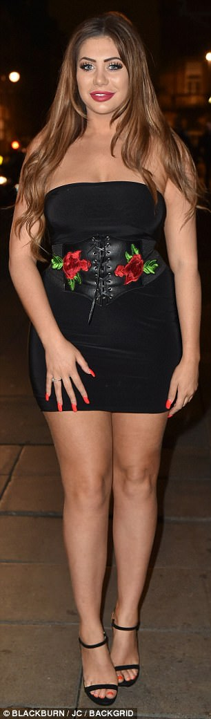 Bottoms up! CBB alum Chloe Ferry slipped into a strapless boob tube dress which was equipped with a corset belt with red rose embroidery