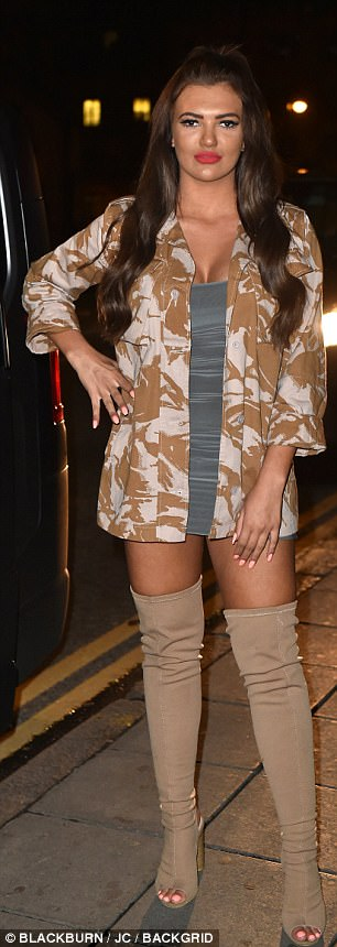 Military chic:Series newbie Abbie slipped into a grey slinky number which she layered with a camoflauge jacket