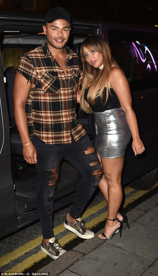 Dazzling:The original Geordie Shore star - who now lives in Essex with Marnie following her split from Lewis - teamed her look with a pair of strappy heels alongside her co-star Nathan Henry
