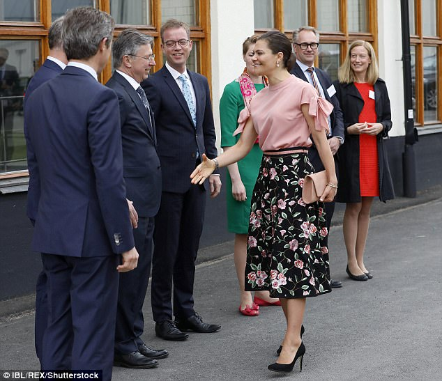 The stylish royal, who wore her hair scraped into a low chignon, warmly greeted her hosts for the day