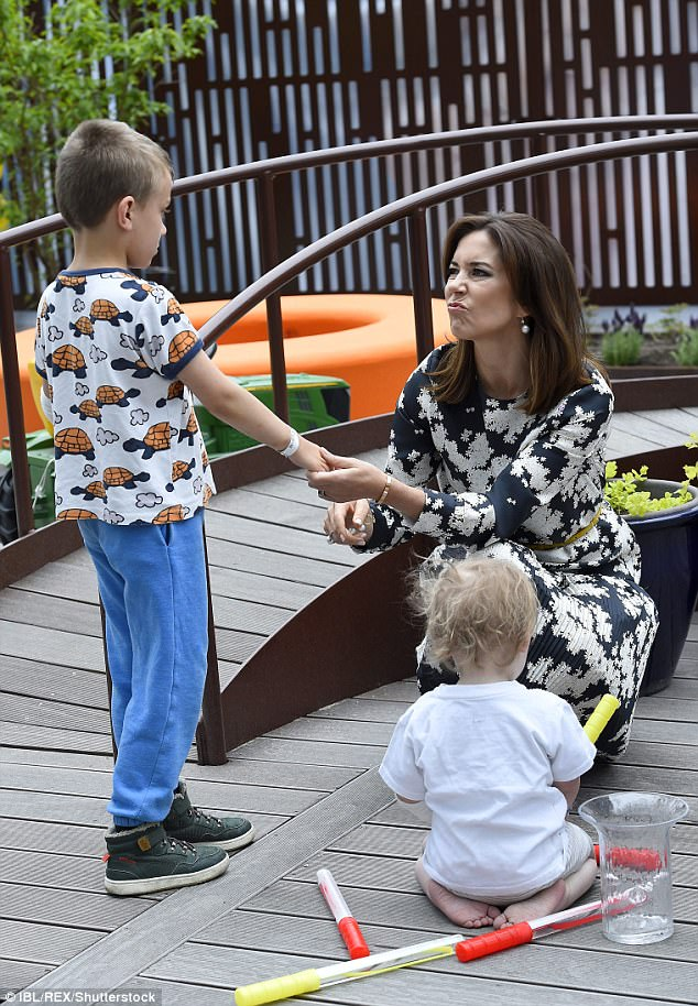 Princess Mary displayed her maternal side as she played with sick children at the hospital