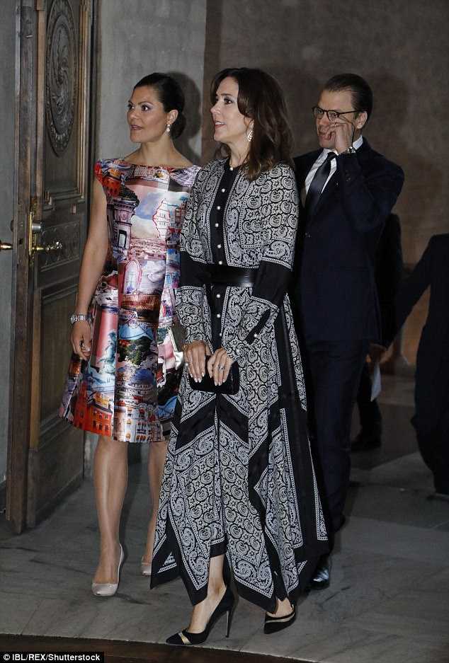 Both royals opted for elaborate print dresses with Crown Princess Victoria opting for a rather colourful number