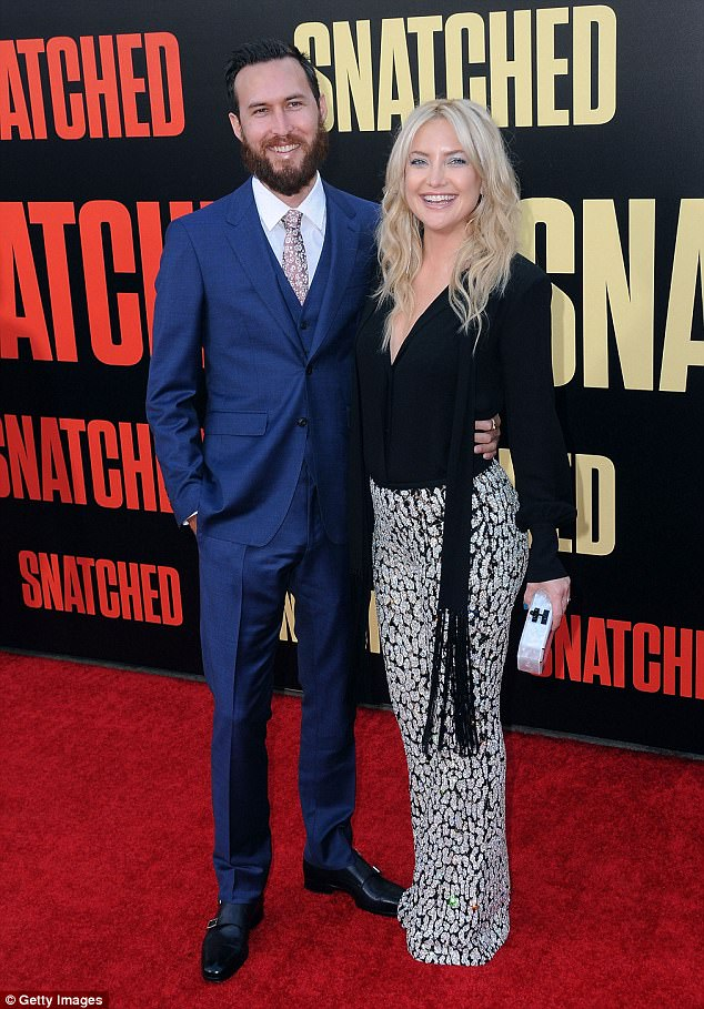 Going public: He and Kate were first romantically linked in March - photos had emerged of the pair running errands together - and they made their red carpet debut as a couple at the premiere of Snatched earlier this month