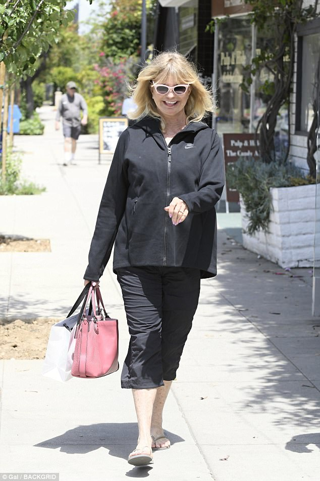 Smile! As Kate was enjoying some downtime with her family in Malibu, her actress mother Goldie, 71, was spotted in high spirits as she stepped out in Brentwood