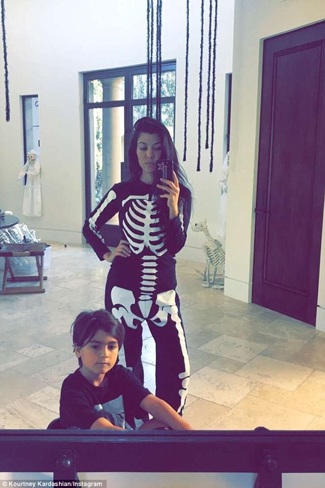 Spooktacular:Kourtney Kardashian, 38, baked some some festive goodies with son Reign while wearing skeleton pajamas on Sunday morning