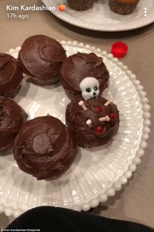 Happy Halloween:North does an amazing job creating a skeleton graveyard on one of the cupcakes