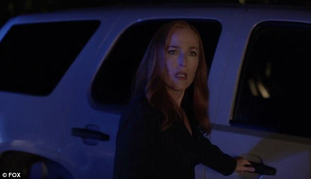The trailer begins with a black screen only being able to hear heavy breathing and Dana Scully speaking to her FBI partner