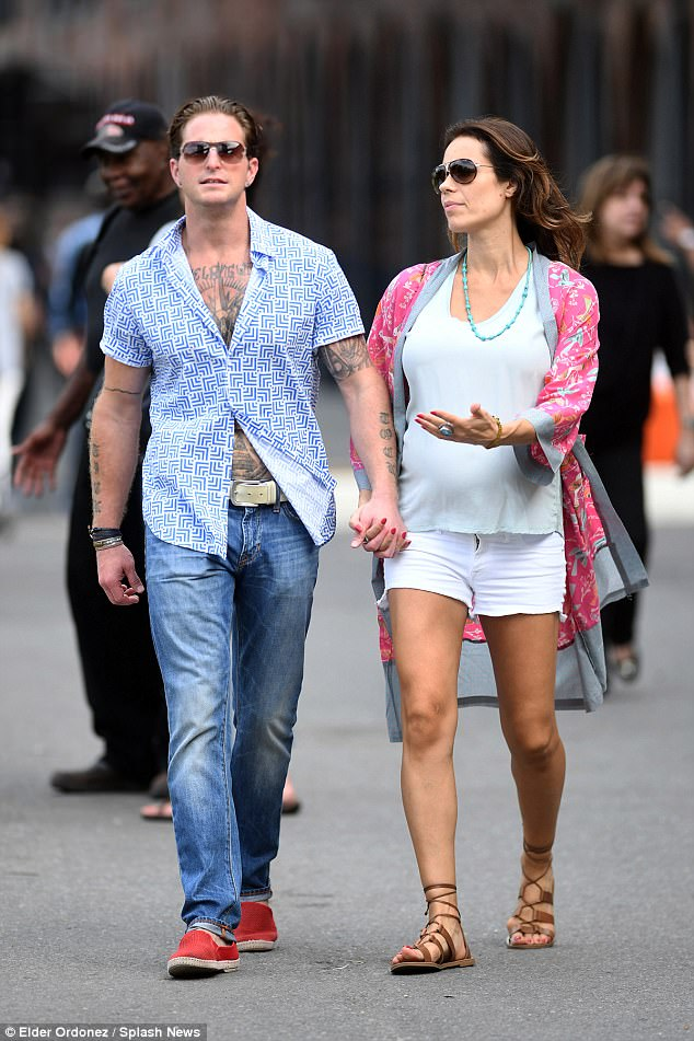 Public display of affection: Cameron Douglas was spotted hand-in-hand with his pregnant girlfriend Viviane Thibes in New York's Brooklyn district on Saturday