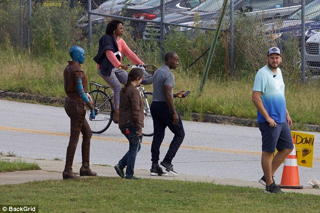 On the go: Karen Gillan was spotted in full blue prosthetic as Nebula, walking not far behind Don Cheadle, who plays War Machine