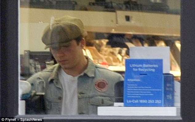Check him out: It looked like Brooklyn acted the gentleman and paid for the shopping