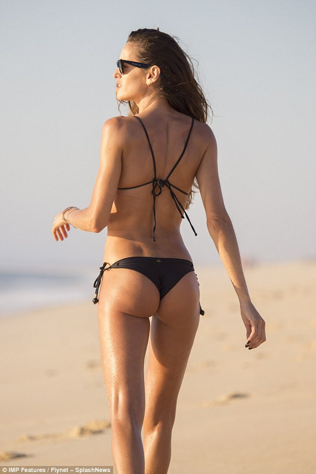 Amazing:Izabel Goulart, 32, looked incredible as she flaunted her peachy derriere and toned stomach while wearing a tiny bikini on holiday in Comporta, Portugal on Friday