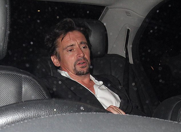 Time to head home: Richard eventually reached an awaiting cab, where he got comfortable by slouching in the back seat