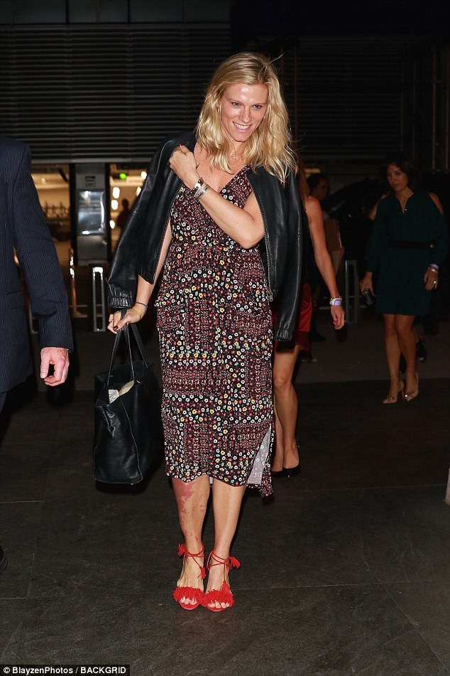 Fashionista: Lindsay Shookus showcased her flair for fashion in a pretty midi-length dress and statement red heels