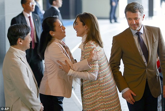 Princess Mary embraced Crown Princess Masako in Tokyo as she and husband Prince Frederik arrived in Tokyo on Sunday