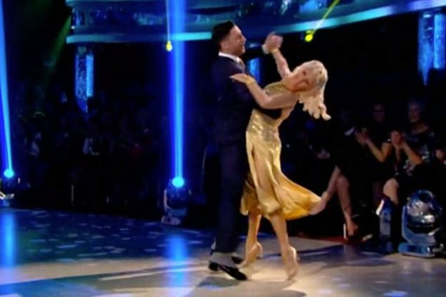 Impressive: Debbie looked absolutely beautiful in her figure-hugging glittering gold gown and a retro hairdo as she flaunted her best dance moves with pro Giovanni