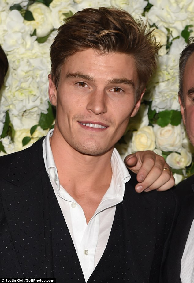 Looking good: Oliver seemed in good spirits on the night as he attended the star-studded bash