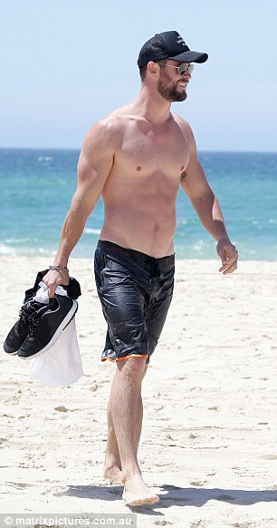 Hunky star! Emerging from the water, droplets were seen glistening over his six-pack and pecs