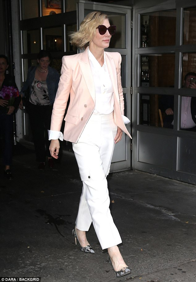 Movie star: The Oscar-winner completed the look with some metallic heels and oversize sunglasses