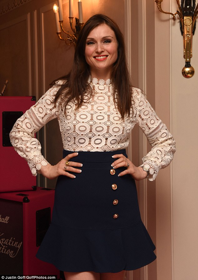 Glamorous:Model and singer Sophie Ellis-Bextor looked stunning in a demure shirt and skirt combination